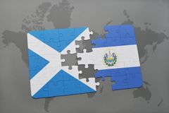 Puzzle with the national flag of scotland and el salvador on a world map Royalty Free Stock Images