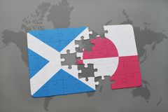 Puzzle with the national flag of scotland and greenland on a world map Royalty Free Stock Image