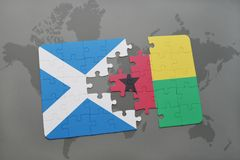 Puzzle with the national flag of scotland and guinea bissau on a world map Royalty Free Stock Images