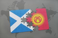 puzzle with the national flag of scotland and kyrgyzstan on a world map Stock Photography