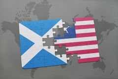 Puzzle with the national flag of scotland and liberia on a world map Royalty Free Stock Image