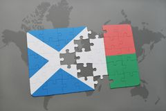 Puzzle with the national flag of scotland and madagascar on a world map Stock Photos