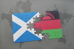 Puzzle with the national flag of scotland and malawi on a world map Royalty Free Stock Images
