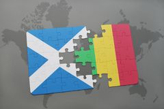 Puzzle with the national flag of scotland and mali on a world map Stock Photo