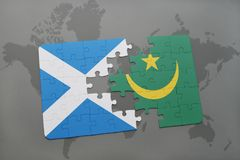 Puzzle with the national flag of scotland and mauritania on a world map Royalty Free Stock Photography