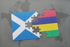 Puzzle with the national flag of scotland and mauritius on a world map Royalty Free Stock Photos