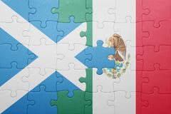Puzzle with the national flag of scotland and mexico. Concept royalty free stock photography