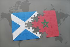 Puzzle with the national flag of scotland and morocco on a world map Royalty Free Stock Photos