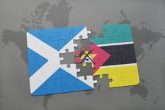 Puzzle with the national flag of scotland and mozambique on a world map Royalty Free Stock Photos