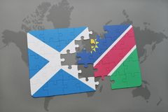 Puzzle with the national flag of scotland and namibia on a world map Royalty Free Stock Photos