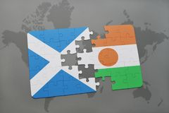 Puzzle with the national flag of scotland and niger on a world map Royalty Free Stock Image