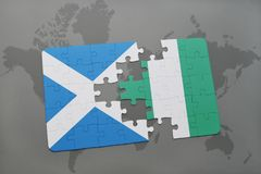 Puzzle with the national flag of scotland and nigeria on a world map Stock Photo