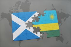Puzzle with the national flag of scotland and rwanda on a world map Royalty Free Stock Image