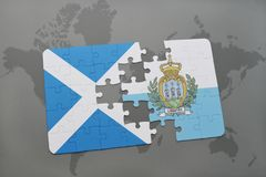 Puzzle with the national flag of scotland and san marino on a world map background. Royalty Free Stock Photo