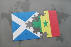Puzzle with the national flag of scotland and senegal on a world map Stock Images