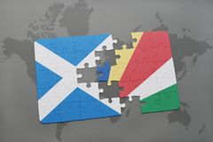 Puzzle with the national flag of scotland and seychelles on a world map Stock Photo