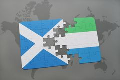 Puzzle with the national flag of scotland and sierra leone on a world map Stock Image