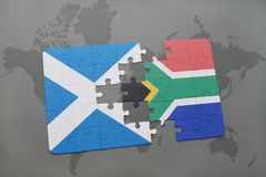 Puzzle with the national flag of scotland and south africa on a world map Stock Photography
