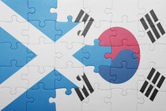Puzzle with the national flag of scotland and south korea. Concept stock photography