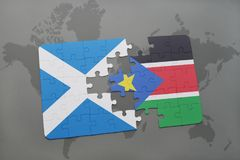 Puzzle with the national flag of scotland and south sudan on a world map Royalty Free Stock Image