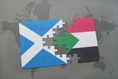 Puzzle with the national flag of scotland and sudan on a world map Royalty Free Stock Photos