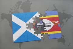 Puzzle with the national flag of scotland and swaziland on a world map Royalty Free Stock Photos