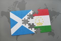 Puzzle with the national flag of scotland and tajikistan on a world map. Background. 3D illustration Stock Image