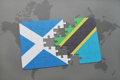 Puzzle with the national flag of scotland and tanzania on a world map Stock Photos