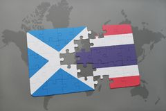 Puzzle with the national flag of scotland and thailand on a world map. Background. 3D illustration Royalty Free Stock Photos