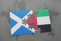 Puzzle with the national flag of scotland and united arab emirates on a world map. Background. 3D illustration Royalty Free Stock Image