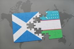Puzzle with the national flag of scotland and uzbekistan on a world map Royalty Free Stock Images