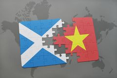 Puzzle with the national flag of scotland and vietnam on a world map Royalty Free Stock Photos