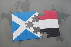 Puzzle with the national flag of scotland and yemen on a world map Royalty Free Stock Photos
