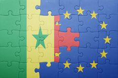 Puzzle with the national flag of senegal and european union Royalty Free Stock Photos