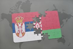 puzzle with the national flag of serbia and belarus on a world map background. Stock Images