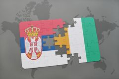 Puzzle with the national flag of serbia and cote divoire on a world map. Background. 3D illustration Royalty Free Stock Image