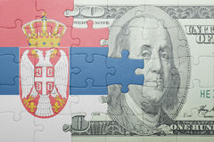 Puzzle with the national flag of serbia and dollar banknote. Concept stock illustration