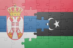 puzzle with the national flag of serbia and libya Royalty Free Stock Photo
