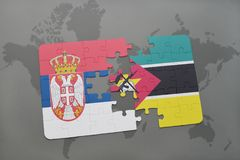 Puzzle with the national flag of serbia and mozambique on a world map. Background. 3D illustration Royalty Free Stock Photography