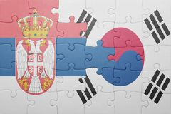 Puzzle with the national flag of serbia and south korea. Concept royalty free stock photo