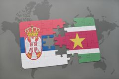 Puzzle with the national flag of serbia and suriname on a world map. Background. 3D illustration Royalty Free Stock Image
