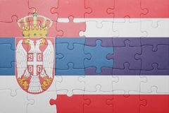 Puzzle with the national flag of serbia and thailand. Concept Stock Photo