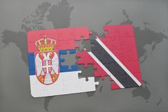 Puzzle with the national flag of serbia and trinidad and tobago on a world map. Background. 3D illustration Stock Photography