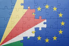 Puzzle with the national flag of seychelles and european union Stock Images