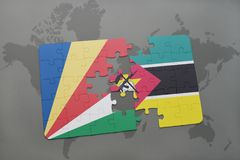 Puzzle with the national flag of seychelles and mozambique on a world map. Background. 3D illustration Stock Photography