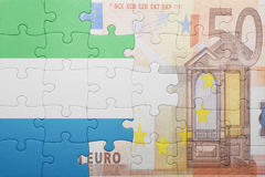 Puzzle with the national flag of sierra leone and euro banknote Stock Photography