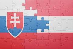 Puzzle with the national flag of slovakia and austria. Concept Royalty Free Stock Image
