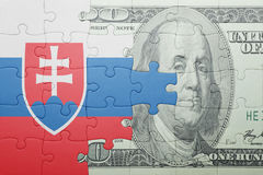 Puzzle with the national flag of slovakia and dollar banknote. Concept royalty free illustration