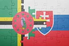 Puzzle with the national flag of slovakia and dominica. Concept stock photography