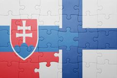Puzzle with the national flag of slovakia and finland. Concept Stock Image